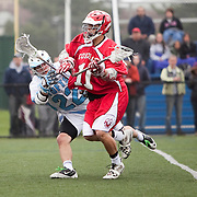 05/18/2011- Medford/Somerville, Mass. - Tufts midfielder Dylan Haas (E13) tries to check Cortland State midfielder Neal Hopps in the Jumbos 10-9 win over Cortland State in the NCAA Tournament Quarterfinals at Bello Field on May 18, 2011. (Kelvin Ma/Tufts University)