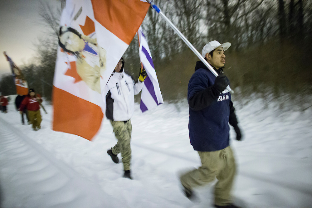 First Nations Protesters march  down the railway tracks after abandoning their blockade of the CN tracks in Sarnia Ontario, Wednesday,  January 2, 2013 after a court injunction ordered them move. The protest, part of the Idle No More movement has blocked the tracks for 13 days.<br /> THE CANADIAN PRESS/ Geoff Robins