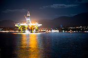 Alien spaceship? No, it's the 400 foot tall Polar Pioneer, an oil platform brought in from Asia piggybacked on a large ship, on its way to Seattle and maybe Alaska. It is temporarily in Port Angeles harbor, seen here from Ediz Hook under a full moon.