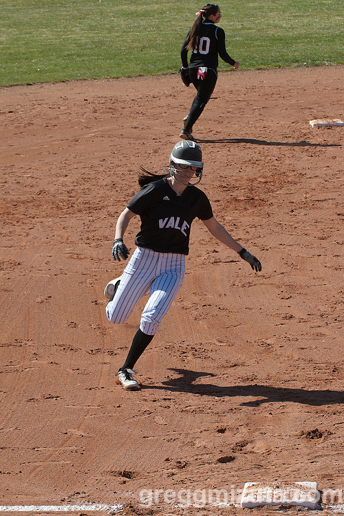 Sasha Morcom prepares to round third during the Vale Payette softball game, March 22, 2014 at Payette, Idaho.