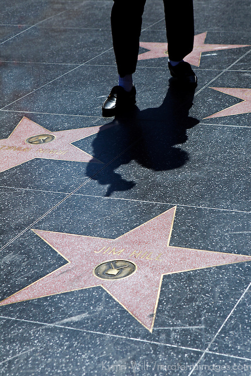 USA, California, Los Angeles. Performer's shadow on Hollywood Walk of Fame on Hollywood Boulevard.
