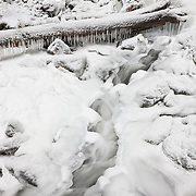 McChord Creek flows under a layer of ice near the base of Elowah Falls on the Oregon side of the Columbia River Gorge. The thick ice formed after a week of subfreezing tempeatures.