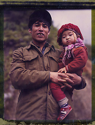 Polaroid 79's portrait of a father and his daughter.