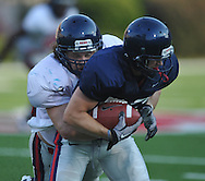 Ole Miss' Josh Lancaster (45) makes a tackle at a team scrimmage at Vaught-Hemingway Stadium in Oxford, Miss. on Saturday, August 20, 2011.