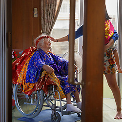 Ninety-seven-year-old Tomi Miyagi prepares for a celebration in her honor at the town hall in Ogimi, Okinawa.