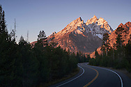 A windy road leading to the cathedral view of the Teton Range in Grand Teton National Park, Wyoming.