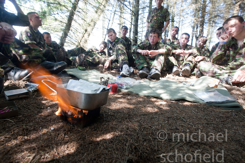 Being shown the army's ration pack..Exercise Guards Warrior with the Scots Guards at their Catterick base..Pic ©2010 Michael Schofield. All Rights Reserved.