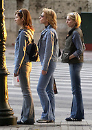 Three Greek women wait to cross the street on Vasilissis Sofias street near the Parliment building in Athens, Greece on October 27, 2002. Photo by Jakub Mosur