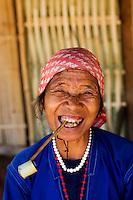 Old Thai woman smoking a pipe, Tha Ton, Chiang Mai Province, Thailand