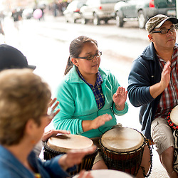 081013       Brian Leddy<br /> Randy Markham leads a drum circle downtown Gallup Saturday during ArtsCrawl.