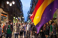 A bid flag of the republic in the Jaume I street of Barcelona. People march to the city council of Barcelona to claim a referendum on republic. / More than 5 thousands of people in Barcelona city took the Catalonia Square on Monday evening to demand a referendum on monarchy or republic, after King Juan Carlos announced his plans to abdicate and hand over power to his son Felipe. In Catalonia many people see the king as part of Spain's problems of the economic crisis. As the political analysts have linked the abdication to the issue of Catalonia's Independence, people on Barcelona's streets have claimed the independence supported by some political parties as CUP, ERC, ICV and others. 2th June 2014. Barcelona city center. Eva Parey/4SEE.
