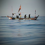 Fishermen pull in their catch into their small wooden boat a few hundred meters away from shore near Cape Coast, roughly 120km west of Ghana's capital Accra on Thursday April 9, 2009.