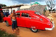 Man with his car in Orlando Nordase, Mariel, Artemisa, Cuba.