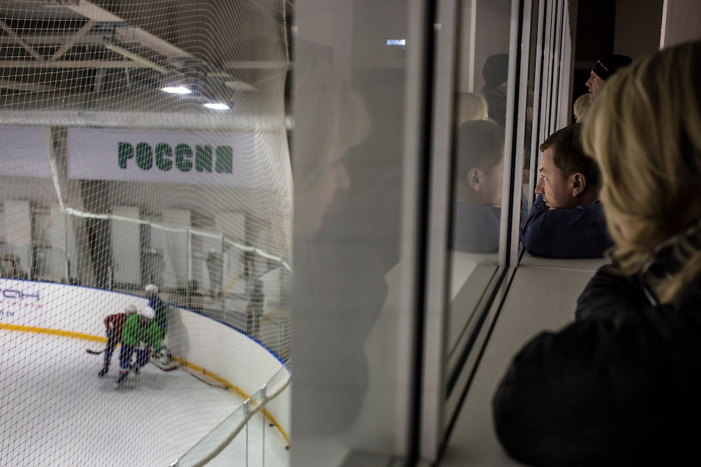 Parents watch their children at hockey practice on Saturday, November 30, 2013 in Asbest, Russia. The youth teams in Asbest, named Chrysotile after the form of asbestos mined locally, are among the best in the Ural region.