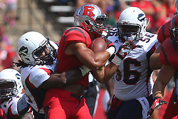 Sep 6, 2014; Piscataway, NJ, USA; Rutgers Scarlet Knights running back Paul James (34) runs with the ball during the first half at High Points Solutions Stadium.