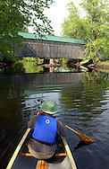 Canoeing Otter Creek past the West Salisbury covered bridge, Salisbury, Vermont.                          ..