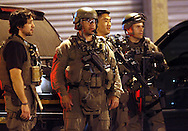 Heavily armed FBI agents outside 222 Lutheran Street in the City of  Newburgh, NY on Thursday morning, May 21, 2009. Four Newburgh men were arrested Wednesday evening in an alleged plot to shoot down military planes at Stewart Airport and bomb a Jewish synagogue in the Bronx.
