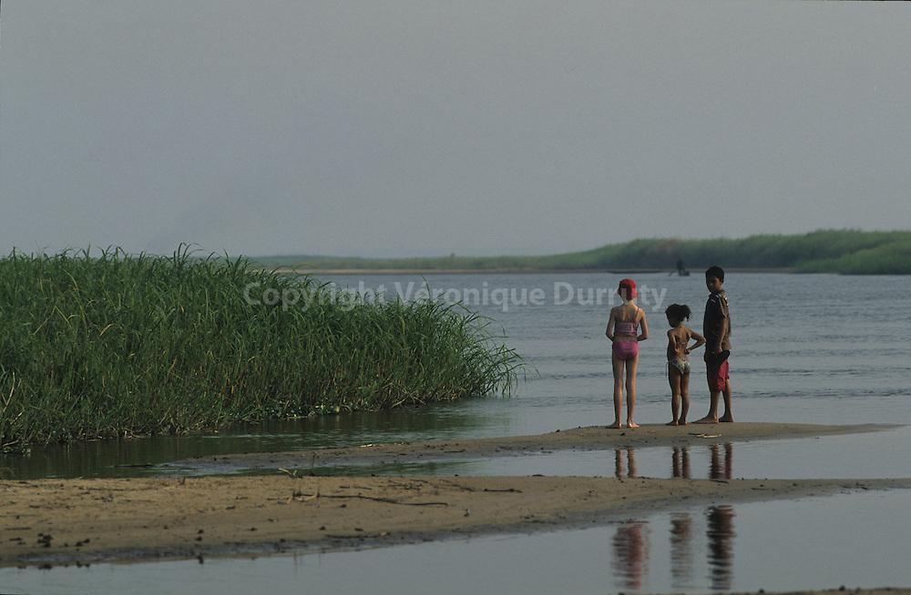 CHILDREN PLAYING. FAIGNON ISLAND, CONGO