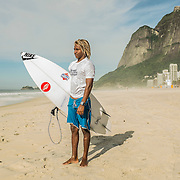 """Gabriel """"Popó"""", 19, surfer. When he was 6, Bocão taught him to surf. Since then his dream is to became a professional surfer competitor, and a week ago he made the final and placed third in Rocinha Surfers Association first contest. One of Rocinha best surfers, he spends the whole day at the beach – a way to avoid his alcoholic parents at home. Although he is a very talented surfer, he doesn't have that kind of family structure and doesn't go to school. Lives at infamous Rua 2, drug dealers HQ, but thanks to surfing he didn't end up in organized crime's hands. His three young brothers also surf."""