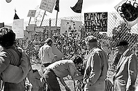 People decorating the perimeter fence after National guards take over the land. Student protest & riots in Berkeley California 1969