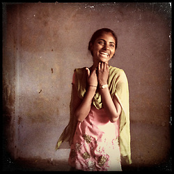 iPhone portrait of Laali Bairwa, 15, in a village outside of Tonk, Rajasthan, India, April 3, 2013. &quot;My circumstances were such that my mother had passed away and there was no one to do the work. So I complied and thought, 'Alright I will not study, my life is ruined.' Then I went to my father in tears saying, 'Please, I will do the work and study  at the same time.' I said to my father, &lsquo;Do not get me married. I do not want to marry. I want to study. If you want to educate me, then do it, or I will study on my own.&rsquo; If I can say no to my father, then even you can say no,&rdquo; said Bairwa. <br /> <br /> Under Indian law, children younger than 18 cannot marry. Yet in a number of India&rsquo;s states, at least half of all girls are married before they turn 18, according to statistics gathered in 2012 by the United Nations Population Fund (UNFPA). However, young girls in the Indian state of Rajasthan&mdash;and even a few boys&mdash;are getting some help in combatting child marriage. In villages throughout Tonk, Jaipur and Banswara districts, the Center for Unfolding Learning Potential, or CULP, uses its Pehchan Project to reach out to girls, generally between the ages of 9 and 14, who either left school early or never went at all. The education and confidence-building CULP offers have empowered youngsters to refuse forced marriages in favor of continuing their studies, and the nongovernmental organization has provided them with resources and advocates in their fight.