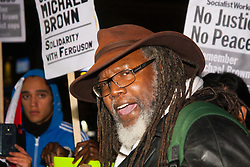 London, November 26th 2014. A vigil for teenager Mike Brown who was shot dead by a policeman in Ferguson, Missouri this year, takes place outside the US embassy in London. Anti-racism and human rights campaigners called the 'emergency' protest following a court verdict that clears Police Officer Darren Wilson of murder. PICTURED: An RMT trade unionist speaks to the gathered crowd.