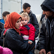 2016 January–Tabanovce, Macedonia. A young refugee family arrived at the Tabanovce Train Station, their stop before they cross the border into Serbia, on their way into Western Europe. Mercy Corps is among the organizations that provide critical information to refugees and arrange for and offer transport for vulnerable people, so they don't have to walk in difficult conditions. A daily average of 2,400 refugees have crossed into Serbia throughout the winter. Warmer months saw highs of 10,000 arrivals. There is no train schedule-the trains leave Gevgelija, Macedonia (at the Greece border) when they fill up, therefore over the winter two to three trains a day have been arriving in Tabanovce at varying times of day and in the middle of the night.