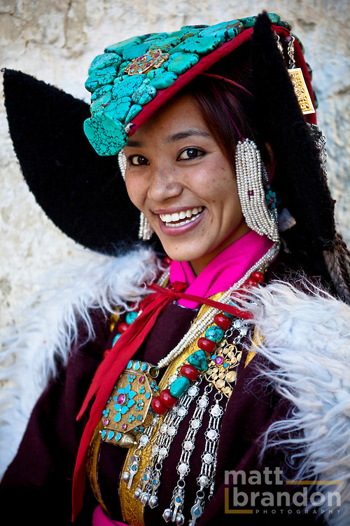 A beautiful Ladakhi women in traditional costume jewelry.