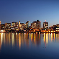 Boston skyline photography from New England based award winning photographer Juergen Roth showing landmarks such as Boston Downtown, Custom House of Boston, New England Aquarium, Boston Harbor, Financial District and Prudential Center captured on a beautiful sunset night at twilight. <br />
