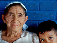 COYOLITO (Tejutla), CHALATENANGO, EL SALVADOR- MAY 2000: A mother and her son, who live outside of Coyolito, traveled into the town for supplies. The woman said she was 35-years-old but appears to be an mujer mayor (old woman). (Photo by Robert Falcetti). .