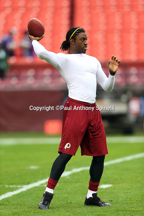 Washington Redskins quarterback Robert Griffin III (10) throws a pregame pass before the NFL week 14 football game against the Baltimore Ravens on Sunday, Dec. 9, 2012 in Landover, Md. The Redskins won the game in overtime 31-28. ©Paul Anthony Spinelli