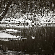 Snow on Spring River on a cold february day in Missouri.