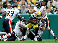 Green Bay's Donald Driver is tackled after a 14-yard pass from Brett Favre in the 3rd quarter. Driver was tackled by Chris Harris and Brian Urlacher. .The Green Bay Packers hosted the Chicago Bears at Lambeau Field Sunday September 9, 2006. Steve Apps-State Journal.