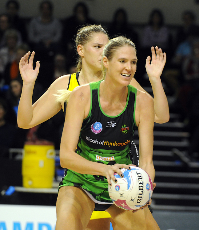 Fever's Caitlin Bassett plays in front of Pulse's Te Huinga Reo Selby-Rickit in the ANZ Netball Championship, TSB Bank Arena, Wellington, New Zealand, Sunday, April 19, 2015. Credit:SNPA / Ross Setford