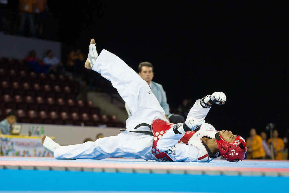 Jose Cobas of Cuba celebrates after defeating Rene Lizarraga of the Mexico in their semi-final contest in men's taekwondo -80 kg division at the 2015 Pan American Games in Toronto, Canada, July 21,  2015.  AFP PHOTO/GEOFF ROBINS