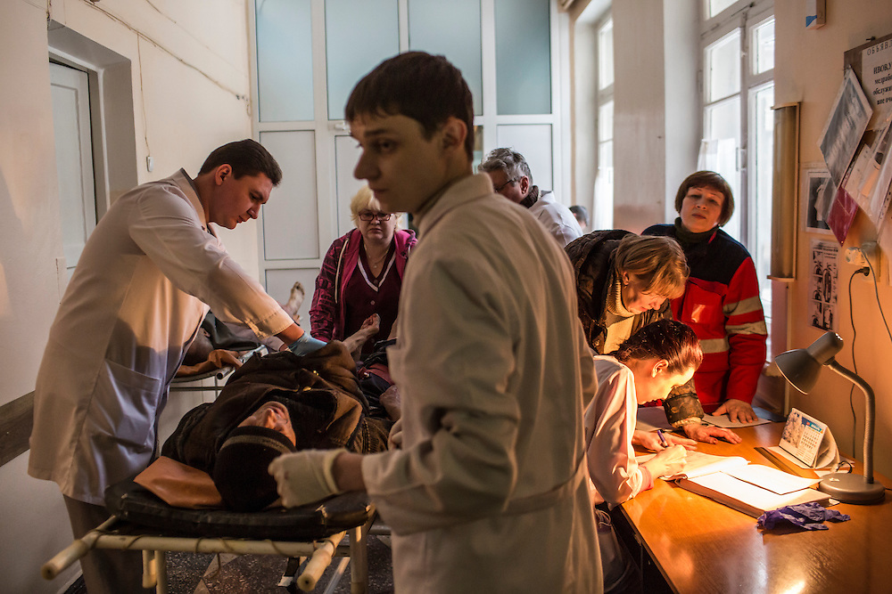 DONETSK, UKRAINE - JANUARY 28, 2015: A man injured by shelling is tended to by doctors at Hospital 24 in Donetsk, Ukraine. He was brought from the Petrovskyi distrct in the city's southwest, which is close to heavy front-line fighting in Marinka. CREDIT: Brendan Hoffman for The New York Times