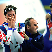 Team Italia member Enricoo Fabris (left) celebrates with one of his coaches after winning the gold medal at the Men's Team Pursuit Speed Skating Finals at the Oval Lingotto in Turin, Italy on Thursday February 16, 2006. Italy beat Canada in the Final A at the event..(Photo by Marc Piscotty / © 2006)