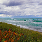 &quot;Colors of Autumn on Lake Superior&quot; <br /> <br /> Beautiful white capped waves roll across the blue-green waters of Lake Superior during an autumn storm! Orange fall foliage blues in the wind as the clouds pass swiftly by!