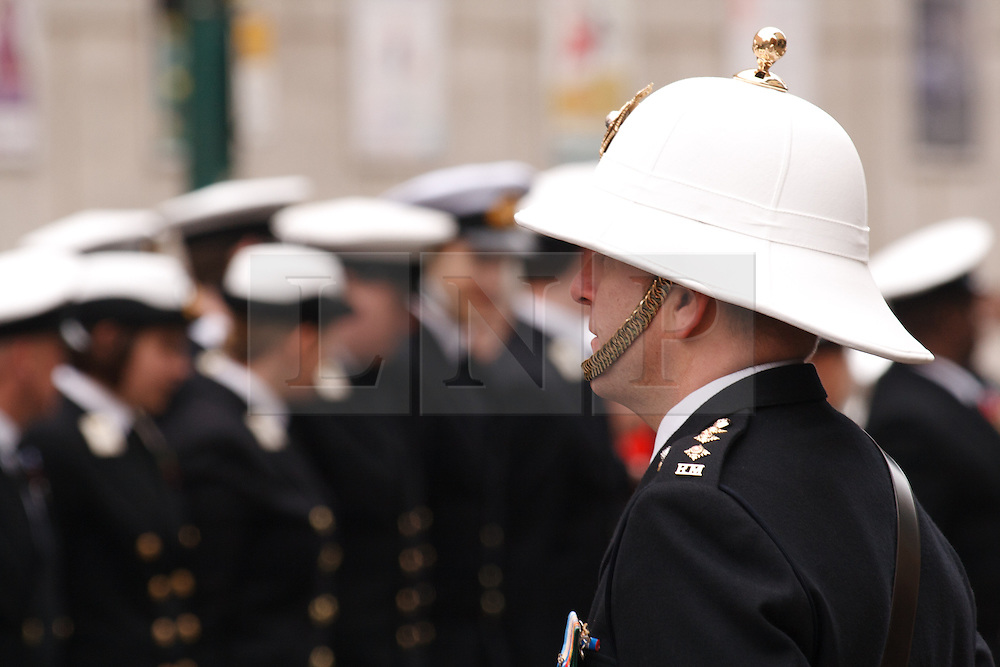 © under license to London News Pictures. 14/11/2010.  Royal Marine Captain stands in front of his troops on Remembrance Sunday in Birmingham before they march to Centenary Square. Photo credit should read Jason Patel/London News Pictures