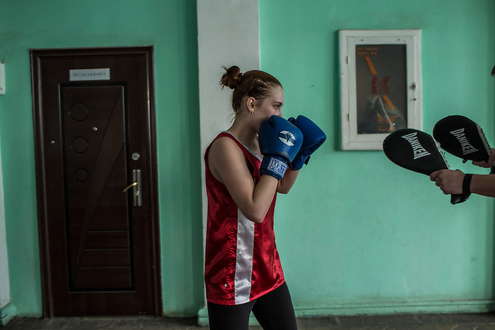 Alina, who has been boxing for about five months, trains at the Shakhtar Palace of Sport on Wednesday, March 23, 2016 in Donetsk, Ukraine.