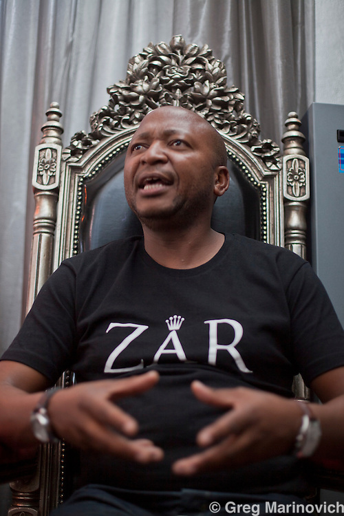 Johannesburg, South Africa, 3 February, 2011: Kenny Kunene, 40, wears a t-shirt with the name of his club ZAR in Sandton, Johannesburg Feb 3, 2011. Kunene, who served 6 years for fraud, is now a consultant, government lobbyist and corp comms exec to a mining company. Photo Greg Marinovich / Storytaxi.