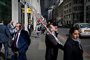 In spring sunshine, a City worker incongruously carries a pair of wrapped skis through the Square Mile, on 3rd March 2017, in the City of London, England.