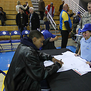 Delaware 87ers Forward JR Inman (33) signs a autograph for a young fan following a 115-88 NBA D-league regular season lost to the Idaho Stampede Thursday, Dec. 12, 2013 at The Bob Carpenter Sports Convocation Center, Newark, DE