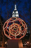 Illuminated sculpture and Empire State Building.