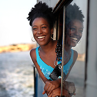 A young woman catches the breeze as she takes the ferry to Regla from Havana, Cuba.