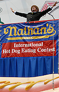 NEW YORK, NY-06 JUL04-- MC George Shea fires up the crowd with some hot dog rhetoric before the competition. (Extra) The Gazette/Liam Maloney