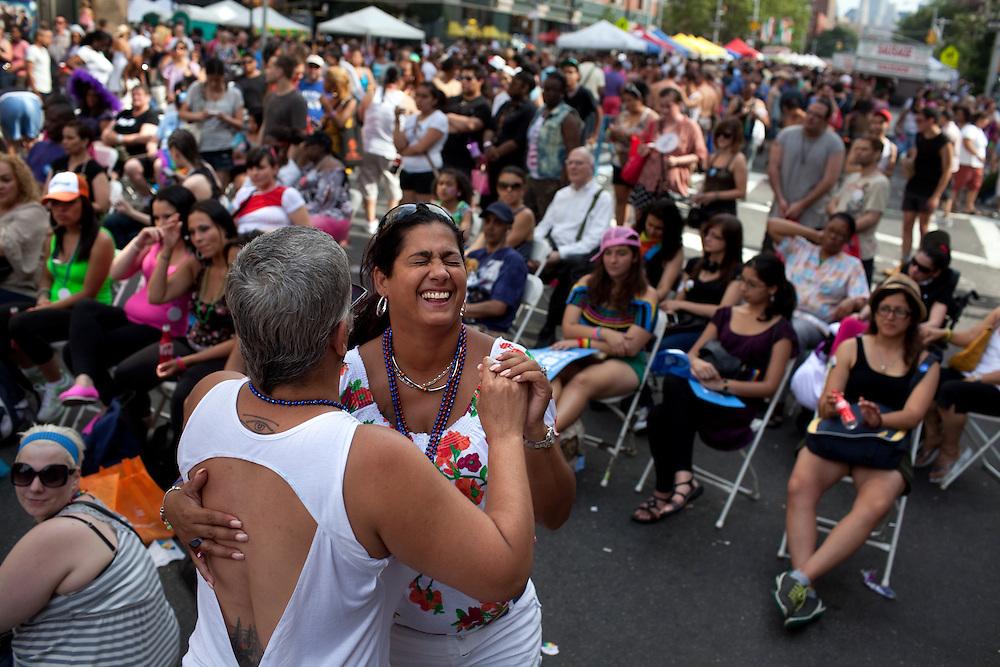 Iris Rivera dances with Rosie Martinez during Gay Pride celebrations in Chelsea, New York on June 24, 2012.