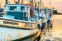 Morning light on a row of fishing trawler's at Wancheese harbor.