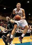 Teddy Metzen grabs a rebound in the division I District Finals against Dublin Coffman. The Wildcats lost 50-61.