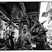 """Red Shirt supporters gather during a rally Saturday, May 19, 2012 to remember those killed by Thai security forces two years earlier during riots in the Thai capital.  At least 92 people were killed during the clashes between supporters of the """"Red Shirts"""" and security forces."""